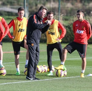 PICTURE: LvG makes his point to Mata and Herrera in Friday's Manchester United training session