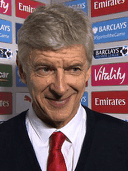 Arsene Wenger currently looks like the cat who got the cream, the tuna and the mouse to play with